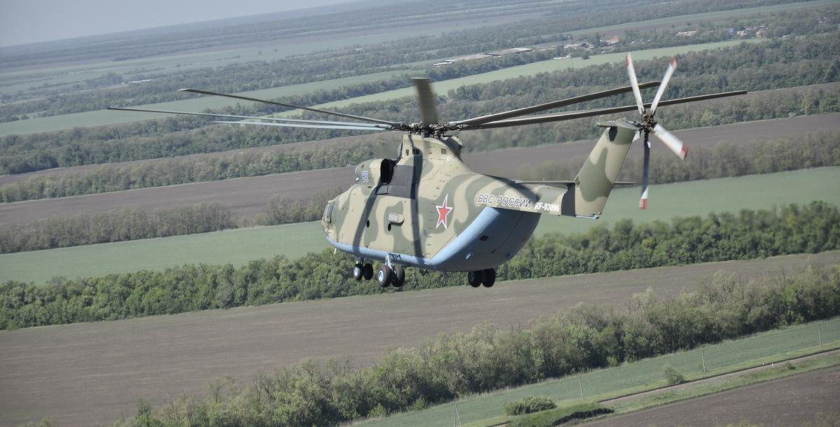 Под винтом вертолета о чем-то поет зеленое поле…
